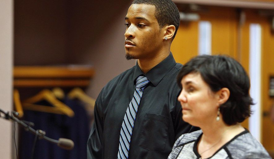 ADDS VANCE OF LAST NAME TO DEMETRIC - Former Michigan State football player Demetric Vance, left, and his attorney Mary Chartier appear in court, Tuesday, June 6, 2017, in East Lansing, Mich. Vance and two other Michigan State football players were charged Tuesday with criminal sexual conduct in connection with an incident that occurred on campus in January.  (Mike Mulholland/The Grand Rapids Press via AP)