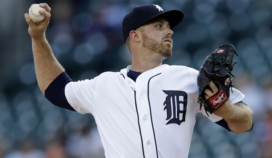 Detroit Tigers starting pitcher Buck Farmer throws during the first inning of a baseball game against the Los Angeles Angels, Wednesday, June 7, 2017, in Detroit. (AP Photo/Carlos Osorio)
