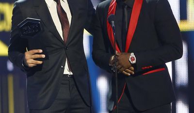 """Luke Bryan, left, and Jason Derulo accept the award for CMT performance of the year for """"Want To Want Me"""" at the CMT Music Awards at Music City Center on Wednesday, June 7, 2017, in Nashville, Tenn. (Photo by Wade Payne/Invision/AP)"""