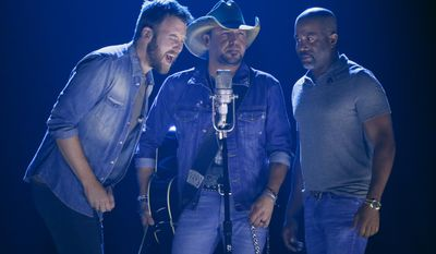 "Charles Kelley, from left, Jason Aldean, and Darius Rucker perform ""Midnight Rider"" during a tribute to Greg Allman at the CMT Music Awards at Music City Center on Wednesday, June 7, 2017, in Nashville, Tenn. (Photo by Wade Payne/Invision/AP)"