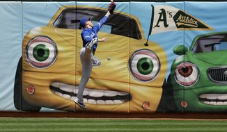 Toronto Blue Jays' Chris Coghlan cannot catch an RBI-double hit by Oakland Athletics' Khris Davis during the first inning of RBI-double a baseball game in Oakland, Calif., Wednesday, June 7, 2017. (AP Photo/Jeff Chiu)