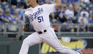 Kansas City Royals starting pitcher Jason Vargas throws during the first inning of a baseball game against the Houston Astros Wednesday, June 7, 2017, in Kansas City, Mo. (AP Photo/Charlie Riedel)