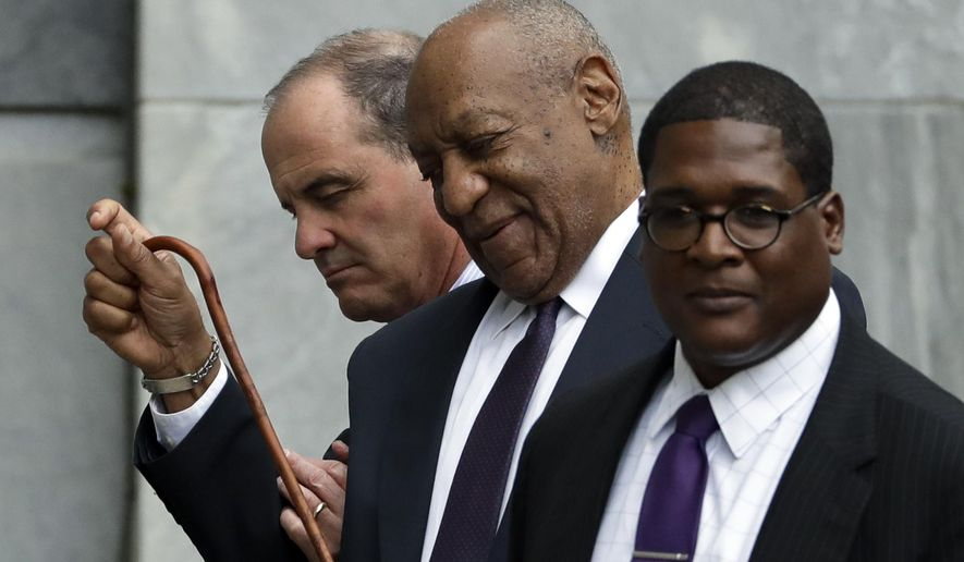 Bill Cosby reacts to a call from the crowd as he walks from the Montgomery County Courthouse during his sexual assault trial, Tuesday, June 6, 2017, in Norristown, Pa. (AP Photo/Matt Slocum)