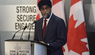 Canada's Defense Minister Harjit Sajjan unveils the Liberal government's long-awaited vision for expanding the Canadian Armed Forces during a news conference in Ottawa, Wednesday June 7, 2017. (Adrian Wyld/The Canadian Press via AP)