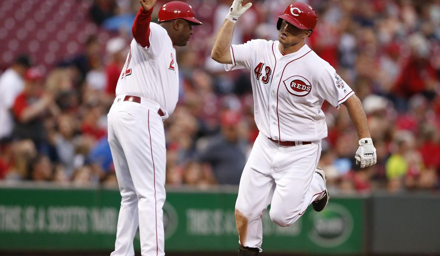 Cincinnati Reds' Scott Schebler (43) is congratulated by third base coach Billy Hatcher on a solo home run off St. Louis Cardinals starting pitcher Lance Lynn during the fifth inning of a baseball game, Wednesday, June 7, 2017, in Cincinnati. (AP Photo/Gary Landers)