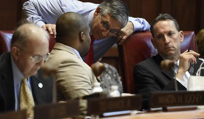 Senate Republican President Pro Tempore Len Fasano, R-North Haven, center, speaks with Sen. Gary Winfield, D-New Haven, left, and Sen. Paul R. Doyle, D-Wethersfield, on the final day of session at the State Capitol, Wednesday, June 7, 2017, in Hartford, Conn. (AP Photo/Jessica Hill)