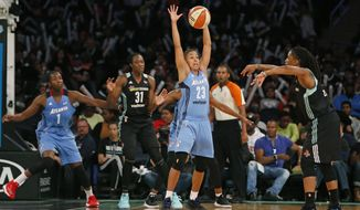 Atlanta Dream guard Layshia Clarendon (23) defends against the pass from New York Liberty guard Shavonte Zellous, far right, in the first half of an WNBA basketball game in New York, Wednesday, June 7, 2017. (AP Photo/Kathy Willens)