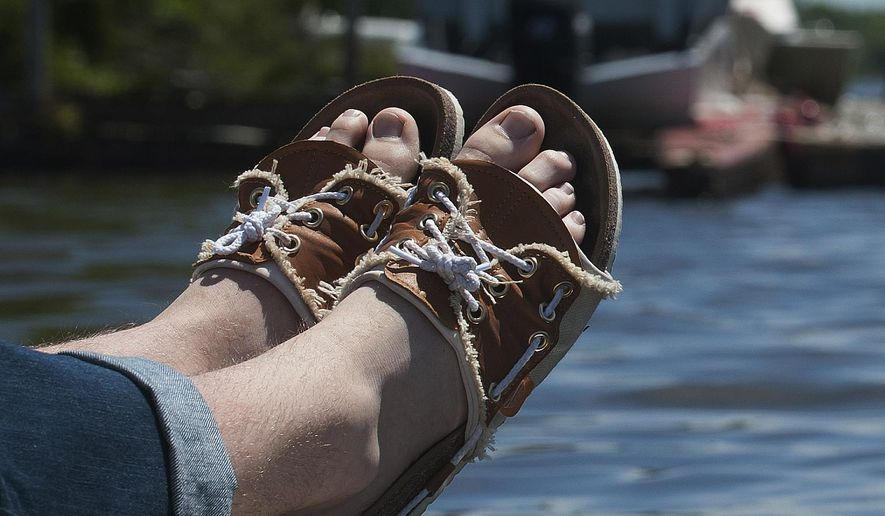 In this May 16, 2017, photo, Shane Pisko, founder of Cape Dory Rigging shoes, shows his new design boat shoe/sandal hybrid he has created, as he poses for a photo in Runnemede, N.J. (Jose F. Moreno/Camden Courier-Post via AP)