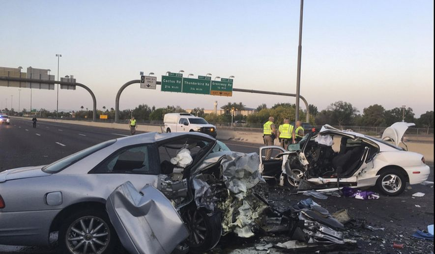 FILE - This April 14, 2017, file photo provided by the Arizona Department of Public Safety (DPS) shows the mangled remains of cars involved in a fatal accident on the Northbound Interstate 17 in Phoenix, Ariz. Northbound Interstate 17 is closed following the wrong-way crash. The DPS said there have been 737 incidents involving wrong-way drivers reported so far in 2017, resulting in 37 related DUI arrests. Gov. Doug Ducey reacted Wednesday, June 7, to the latest fatal wrong-way crash on a Phoenix-area freeway by ordering state agencies to take steps to combat the deadly problem. (Arizona Department of Public Safety via AP, File)