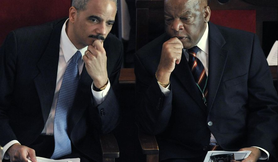 In this March 8, 2009, file photo, U.S. Attorney General Eric Holder, left, shares a moment with Rep. John Lewis, D-Ga., prior to being introduced at the Brown AME Chapel in Selma, Ala., on the 44th anniversary of the Voting Rights March. Holder is being honored for his service to the cause of civil rights from the Washington Lawyers' Committee for Civil Rights and Urban Affairs on Wednesday and Lewis will present the award to Holder. (AP Photo/Kevin Glackmeyer)