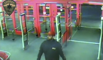 This Sunday, Jan. 15, 2017 surveillance video provided by the Kitsap County Sheriff's Office shows someone detectives describe as a person of interest in a January slaying of four members of the same family. The video, released late Tuesday, June 6 shows the man at a Target store in Silverdale, Wash., about 15 miles west of Seattle, 12 days before the killings took place. (Kitsap County Sheriff's Office via AP)
