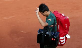 Japan's Kei Nishikori leaves the court after losing to Britain's Andy Murray during their quarterfinal match of the French Open tennis tournament at the Roland Garros stadium, Wednesday, June 7, 2017 in Paris. Murray won 2-6, 6-1, 7-6, 6-1. (AP Photo/Christophe Ena)