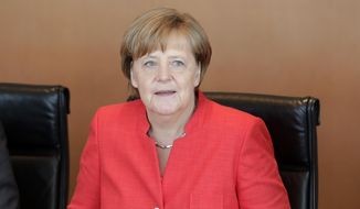 German Chancellor Angela Merkel waits for the beginning of the weekly Cabinet meeting at the Chancellery in Berlin, Germany, Wednesday, June 7, 2017. (AP Photo/Michael Sohn) ** FILE **