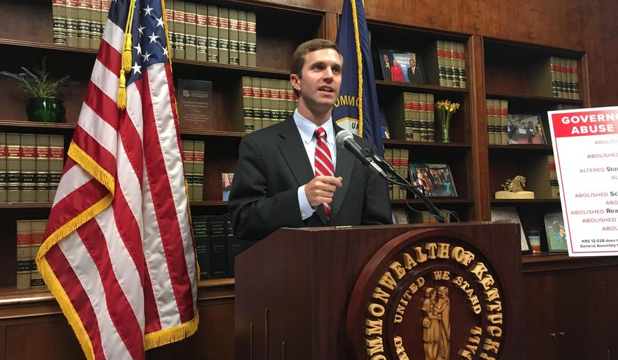 Kentucky Democratic Attorney General Andy Beshear speaks to reporters about his plans to sue Republican Gov. Matt Bevin on Wednesday, June 7, 2017, in Frankfort, Ky.  Beshear says Bevin's executive order last week reorganizing several education boards was illegal. He says he will sue the governor if he does not rescind the order in seven days. A spokesman for Bevin said his actions were legal and proper.  (AP Photo/Adam Beam)