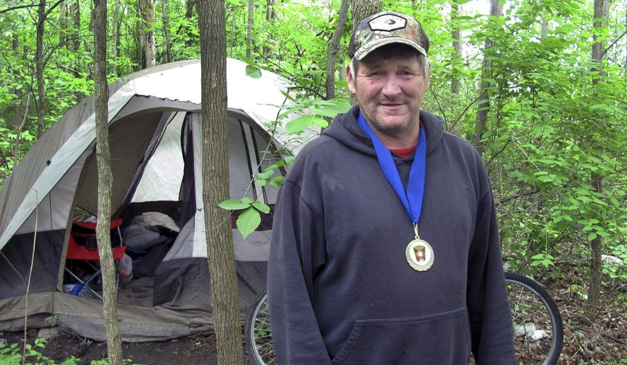 In this Monday, June 5, 2017 photo, James Pocock poses for a photo in Williston, Vt. Pocock was honored by Williston officials after he helped save the life of a truck driver whose vehicle crashed after suffering a heart attack near Pocock's home in the woods.  Local emergency officials said that without Pocock's help driver Paul Bristol would have died.  (AP Photo/Wilson Ring)