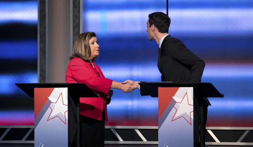 Candidates in Georgia's 6th Congressional District race Republican Karen Handel, left, and Democrat Jon Ossoff shake hands after a debate Tuesday, June 6, 2017, in Atlanta. (Branden Camp/Atlanta Journal-Constitution via AP) ** FILE **