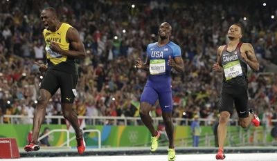 """FILE - In this Thursday, Aug. 18, 2016 file photo, Usain Bolt from Jamaica, left, crosses the line to win the gold medal in the men's 200-meter final ahead of second placed Canada's Andre De Grasse, right, during the athletics competitions of the 2016 Summer Olympics at the Olympic stadium in Rio de Janeiro, Brazil. Andre De Grasse isn't interested in considering the expectation that he'll take over the reins from Usain Bolt as the world's best sprinter when the eight-time Olympic champion retires later this year.De Grasse, who already challenged Bolt at last year's Rio de Janeiro Olympics, believes he's ready to beat Bolt this season. """"I'm trying to win this year. I feel like I have a great chance and that's what I want to do,"""" De Grasse said in an interview with The Associated Press ahead of Thursday's Golden Gala Pietro Mennea meet, where the Canadian will run the 200 meters. (AP Photo/David J. Phillip, File)"""
