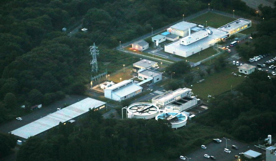 This Tuesday, June 6, 2017 photo shows Oarai Research & Development Center, a facility for nuclear fuel study that uses highly toxic plutonium. Japan's Atomic Energy Agency says five workers at the nuclear facility that handles plutonium have been exposed to high levels of radiation after a bag containing highly radioactive material broke during equipment inspection. (Kyodo News via AP)