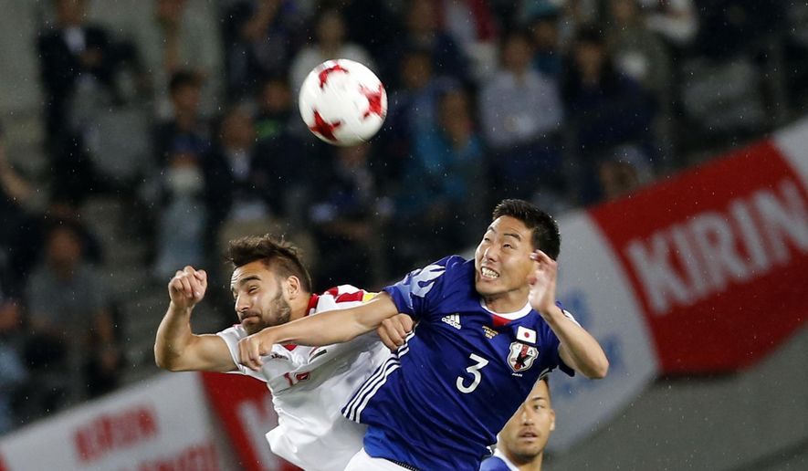 Japan's Gen Shoji, right, and Syria's Mardek Mardkian vie for the ball during their Kirin Challenge Cup international friendly soccer match in Tokyo, Wednesday, June 7, 2017.(AP Photo/Shuji Kajiyama)
