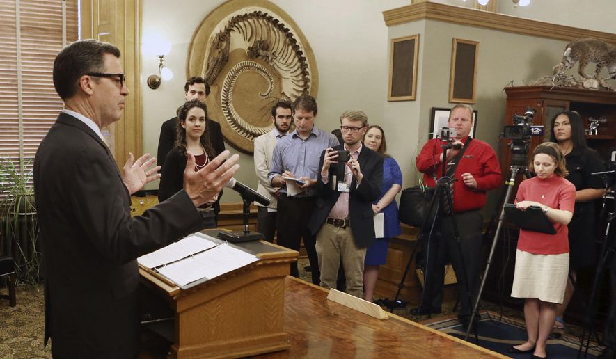 Gov. Sam Brownback gives a statement to the media Wednesday, June 7, 2017, concerning the Senate and House overriding his veto of a bill raising Kansas income taxes by $1.2 billion over two years. The governor left the news conference without taking questions.  (Thad Allton/The Topeka Capital-Journal via AP)