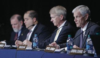 Sean Sullivan, right, chairman of the Defense Nuclear Facilities Safety Board, speaks on Wednesday, June 7, 2017, at the Santa Fe Community Convention Center, during a Defense Nuclear Facilities Safety Board hearing. The hearing was to discuss safety concerns and future operations at Los Alamos National Laboratory's Plutonium Facility. (Luis Sanchez Saturno/The New Mexican via AP)