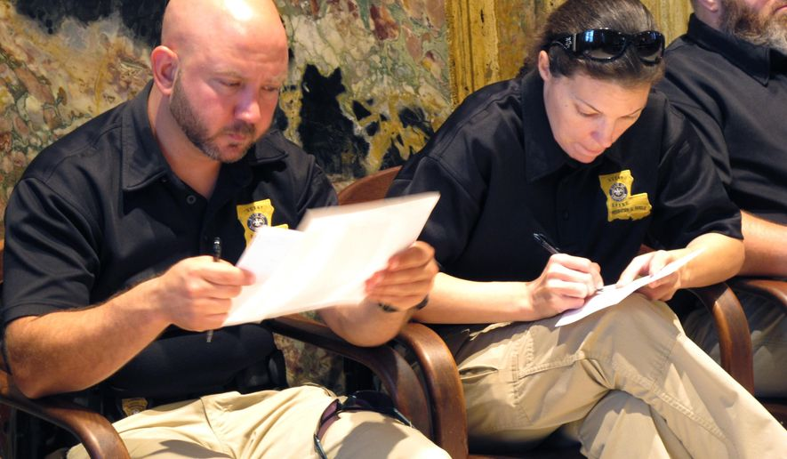 Probation and parole officers fill out messages for lawmakers in the Louisiana House chamber, trying to persuade the Legislature to keep the officers' pay raise in next year's budget, on Wednesday, June 7, 2017, in Baton Rouge, La. (AP Photo/Melinda Deslatte)