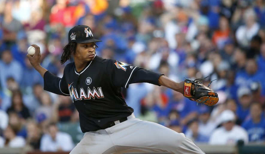 Miami Marlins starting pitcher Jose Urena winds up during the first inning of the team's baseball game against the Chicago Cubs on Wednesday, June 7, 2017, in Chicago. (AP Photo/Charles Rex Arbogast)