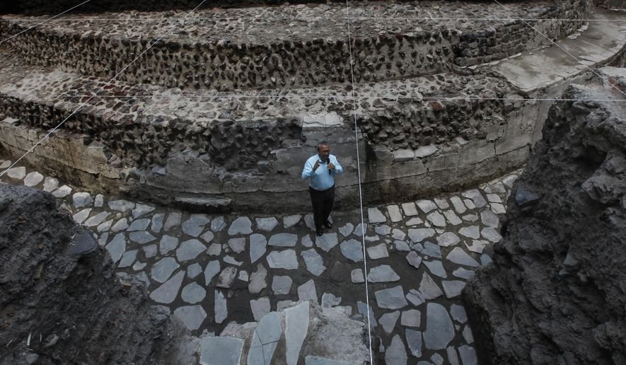 Archaeologist Raul Barrera, from the National Institute of Anthropology and History, talks to the press as he stands in a temple to the Aztec wind god Ehecatl discovered on the property of a hotel in Mexico City, Wednesday, June 7, 2017. Plans to expand the hotel have been put on hold after archaeologists unearthed a 1400's temple and a ceremonial ball court under the property. (AP Photo/Marco Ugarte)
