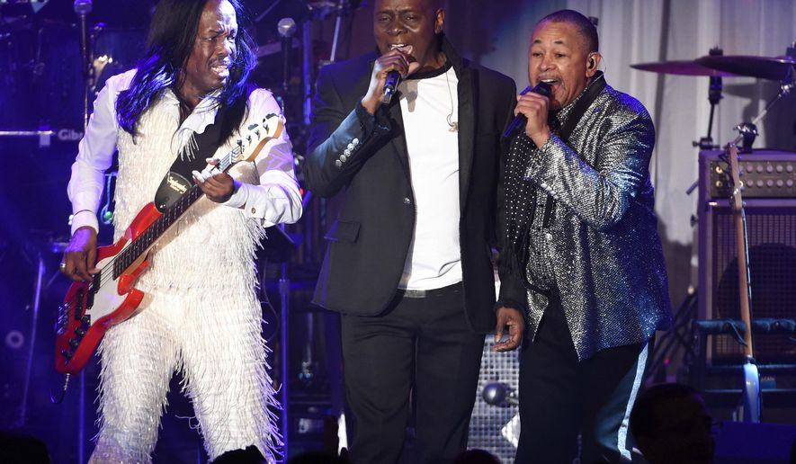 FILE - In this Feb. 14, 2016 file photo, Verdine White, from left, Philip Bailey and Ralph Johnson of Earth, Wind and Fire perform at the 2016 Clive Davis Pre-Grammy Gala in Beverly Hills, Calif. Earth, Wind & Fire will hit the road this summer with the band Chic featuring Nile Rodgers. Their tour starts July 12 in Oakland, Calif. (Photo by Chris Pizzello/Invision/AP, File)
