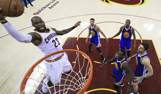 Cleveland Cavaliers forward LeBron James (23) drives to the basket against the Golden State Warriors during the first half of Game 3 of basketball's NBA Finals in Cleveland, Wednesday, June 7, 2017. (Ronald Martinez/Pool Photo via AP)