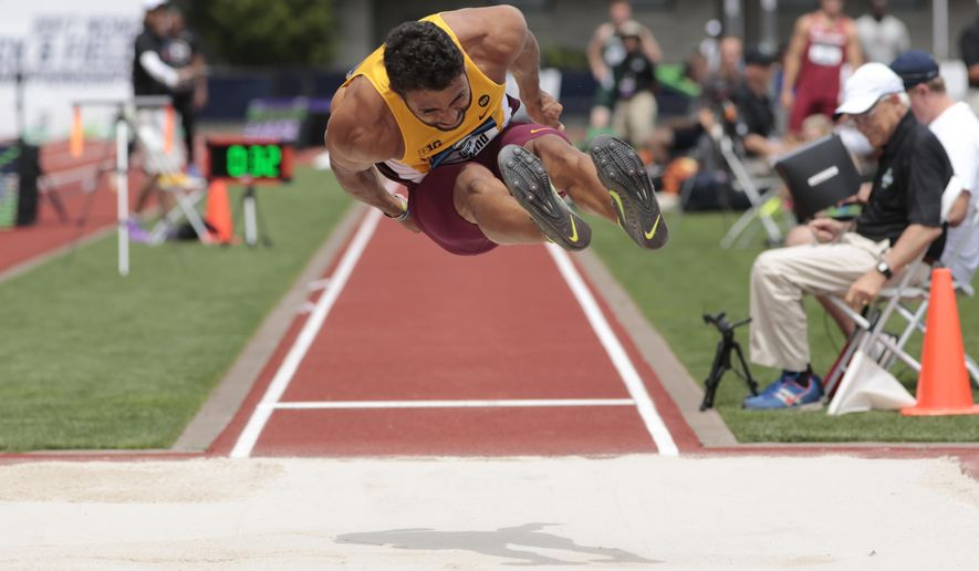 Minnesota's Luca Wieland heads toward the pit in the long jump during the men's decathlon on the first day of the NCAA college track and field championships in Eugene, Ore., Wednesday, June 7, 2017. (AP Photo/Timothy J. Gonzalez)