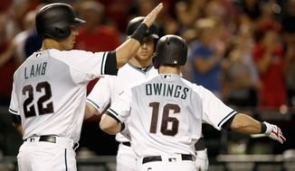 Arizona Diamondbacks' Chris Owings (16) celebrates his three-run home run against the San Diego Padres with Jake Lamb (22) and Brandon Drury during the second inning of a baseball game Tuesday, June 6, 2017, in Phoenix. (AP Photo/Ross D. Franklin)