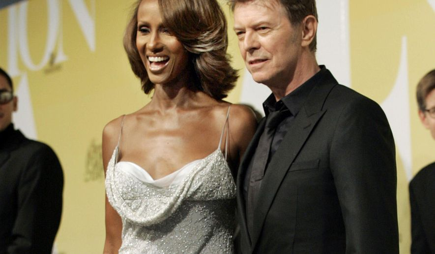 FILE - In this June 6, 2005, file photo, singer David Bowie and his wife Iman pose at the 2005 CFDA Fashion Awards in New York. Iman remembered the late singer with a social media post on June 6, 2017, which would have been their 25th wedding anniversary. (AP Photo/Stuart Ramson, File)
