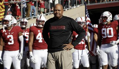 FILE - In this Saturday, Sept. 17, 2016, file photo, Stanford head coach David Shaw prepares to enter the field with his team before an NCAA college football game against Southern California in Stanford, Calif. Not many college football fans outside of Alabama and Ohio State are totally content with their coach. And contentment can be fleeting as Michigan State fans are finding out now. These days Clemson fans are crazy about Dabo Swinney and Stanford supporters are cool with Shaw. (AP Photo/Marcio Jose Sanchez, File)
