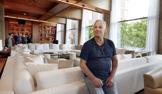 This June 1, 2017 photo shows hotelier Ian Schrager in a lounge area at his new PUBLIC hotel, in New York. The new hotel on Manhattan's Lower East Side opens Wednesday, June 7. It is the latest project from Ian Schrager, who's known for introducing the concept of boutique hotels and as co-founder of the legendary disco Studio 54. (AP Photo/Richard Drew)
