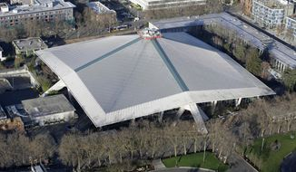 FILE - In this Jan. 29, 2015, file photo, KeyArena, which hosts sports and entertainment events, is seen from the air in Seattle. Seattle Mayor Ed Murray announced Wednesday, June 7, 2017, that the city will enter into negotiations with the Oak View Group on a proposal for a privately-financed renovation of the city-owned KeyArena. Plans for the remodel would bring the building up to standards that could attract an NHL hockey or NBA basketball team once completed. (AP Photo/Ted S. Warren)