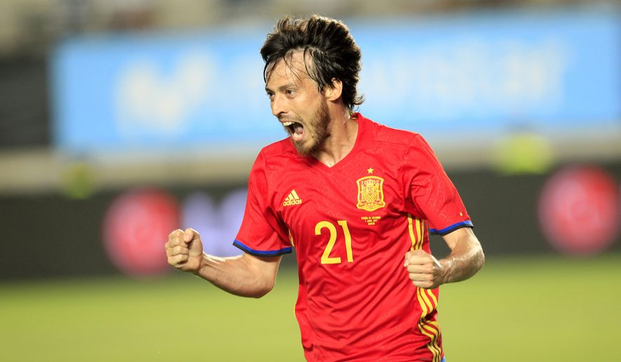 Spain's David Silva celebrates after scoring against Colombia during the international friendly soccer match between Spain and Colombia at the Estadio Nueva Condomina in Murcia, Spain, Wednesday, June 7, 2017. (AP Photo/Alberto Saiz)