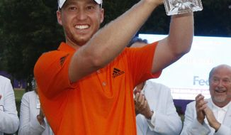 FILE - In this June 12, 2016, file photo, Daniel Berger celebrates winning the FedEx St. Jude Classic golf tournament, in Memphis, Tenn. Berger is back looking to defend his first and only PGA Tour title at the St. Jude Classic. (AP Photo/Rogelio V. Solis, FIle)