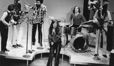 ADVANCE FOR USE TUESDAY, JUNE 13, 2017 AND THEREAFTER-FILE - In this December 1969 file photo, singer Janis Joplin performs with her group Big Brother and the Holding Company. On drums is Dave Getz. The Summer of Love in 1967 marked a turning point in rock and roll history: It introduced America to the exciting new sounds coming out of San Francisco's local music scene. There was the Grateful Dead, Jefferson Airplane, Quicksilver Messenger Service, Big Brother and the Holding Company, which launched Janis Joplin's career, and Country Joe and the Fish, a psychedelic rock band. (AP Photo/File)
