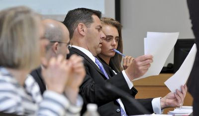 Defense Attorney Joe Cataldo, left, and defendant Michelle Carter, right,  look over photos that were taken at the Homers for Conrad fundraising event that Carter organized several months after Conrad Roy III committed suicide. The trial of Carter proceeds in Taunton District Court in Taunton, Mass., Wednesday, June 7, 2017. She is charged with involuntary manslaughter for encouraging 18-year-old Conrad Roy, III to kill himself in July 2014. (Mark Stockwell/The Sun Chronicle via AP, Pool)