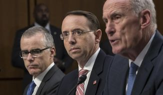 From left: Acting FBI Director Andrew McCabe, Deputy Attorney General Rod Rosenstein and Director of National Intelligence Daniel Coats testified before a hearing Wednesday of the Senate Select Committee on Intelligence. (Associated Press)
