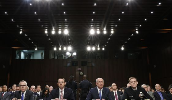 From left, Acting FBI Director Andrew McCabe, Deputy Attorney General Rod Rosenstein, National Intelligence Director Dan Coats, and National Security Agency Director Adm. Michael Rogers are seated during a Senate Intelligence Committee hearing about the Foreign Intelligence Surveillance Act, on Capitol Hill, Wednesday, June 7, 2017, in Washington. (AP Photo/Alex Brandon)
