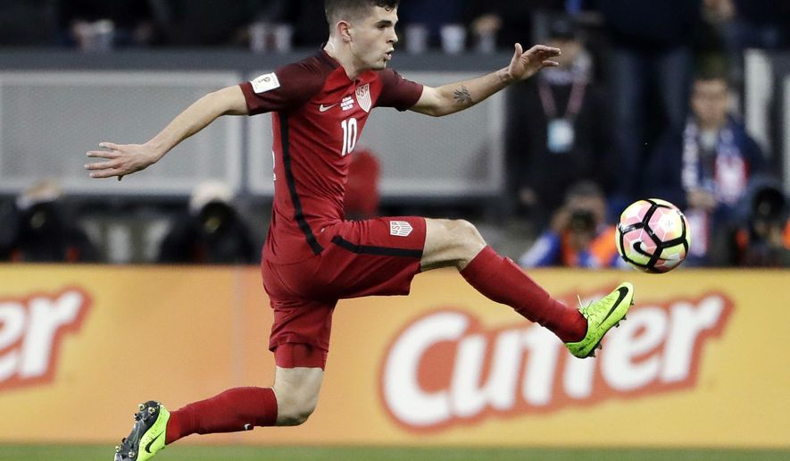 FILE - In this Friday, March 24, 2017, file photo, United States' Christian Pulisic controls the ball during the first half of a World Cup qualifying soccer match against Honduras in San Jose, Calif. Pulisic is just 18, only he doesn't play like he's just 18. Already the youngest American to win a medal with a European club, Pulisic will now lead the U.S. into an important World Cup qualifier against Trinidad and Tobago on Thursday night, June 8. (AP Photo/Marcio Jose Sanchez, File)