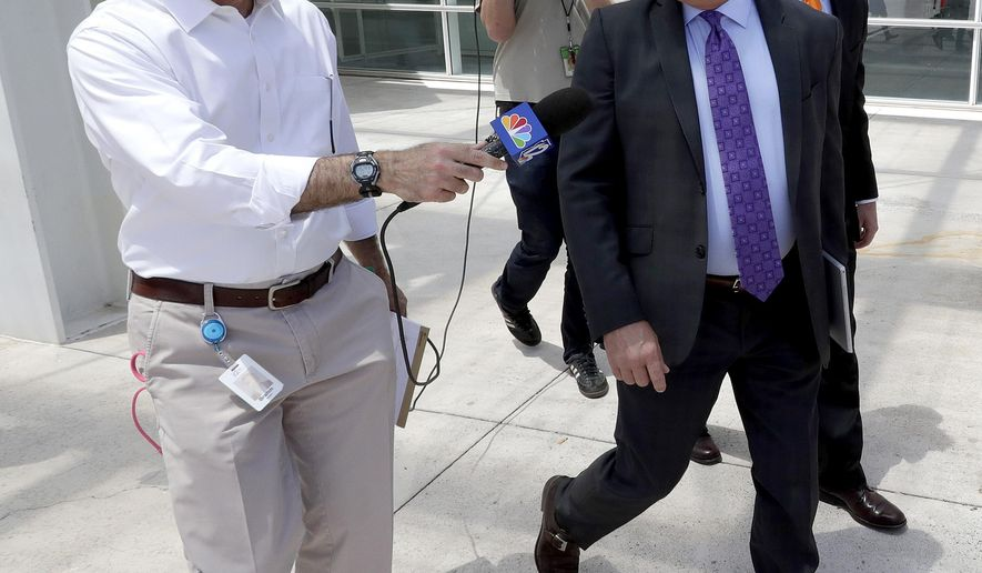 Lobbyist Jim Norton, right, leaves Federal Court after being arraigned for an alleged bribery scheme, Wednesday, June 7, 2017, in Phoenix. Other arraignments included a water company owner, former Arizona utility regulator Gary Pierce and his wife Sherry. (AP Photo/Matt York)