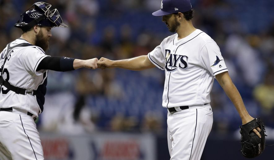 Tampa Bay Rays starting pitcher Jacob Faria, right, fist-bumps catcher Derek Norris after Faria was taken out of the baseball game against the Chicago White Sox during the seventh inning Wednesday, June 7, 2017, in St. Petersburg, Fla. (AP Photo/Chris O'Meara)