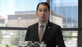 Wisconsin Gov. Scott Walker speaks to reporters during a news conference Wednesday, June 7, 2017, in Madison, Wis. (AP Photo/Scott Bauer) ** FILE **