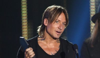 "Keith Urban accepts the award for video of the year for ""Blue Ain't Your Color"" at the CMT Music Awards at Music City Center on Wednesday, June 7, 2017, in Nashville, Tenn. (Photo by Wade Payne/Invision/AP)"
