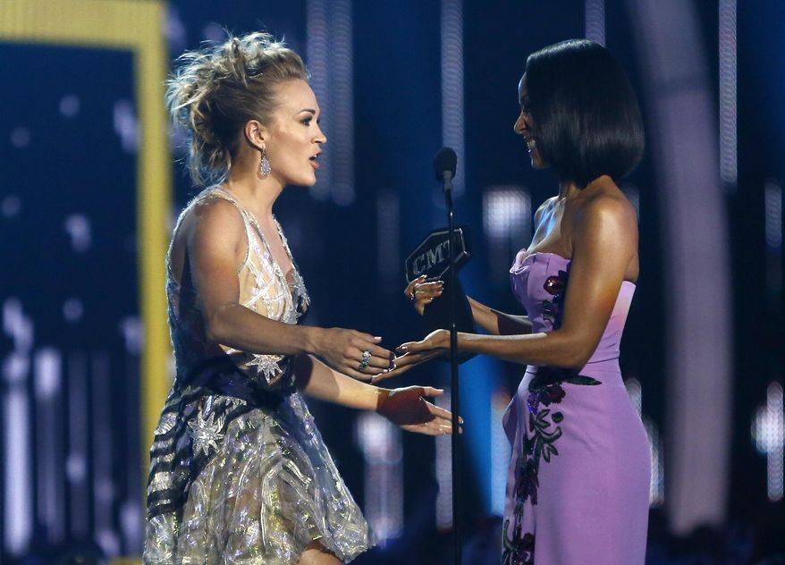 Jada Pinkett Smith, right, presents the award for female video of the year to Carrie Underwood at the CMT Music Awards at Music City Center on Wednesday, June 7, 2017, in Nashville, Tenn. (Photo by Wade Payne/Invision/AP)