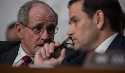 "Idaho Republican Sen. James E. Risch (left) asked Mr. Comey if President Trump specifically directed him to end his investigation into Mr. Flynn. ""You may take it as a direction, but that's not what he said,"" Mr. Risch said, to which Mr. Comey replied, ""Correct."""