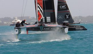 In this photo provided by the America's Cup Event Authority, Great Britain's Land Rover BAR and Emirates Team New Zealand compete during America's Cup challenger semifinals on the Great Sound in Bermuda on Thursday, June 8, 2017.  (Gilles Martin-Raget/ACEA via AP)